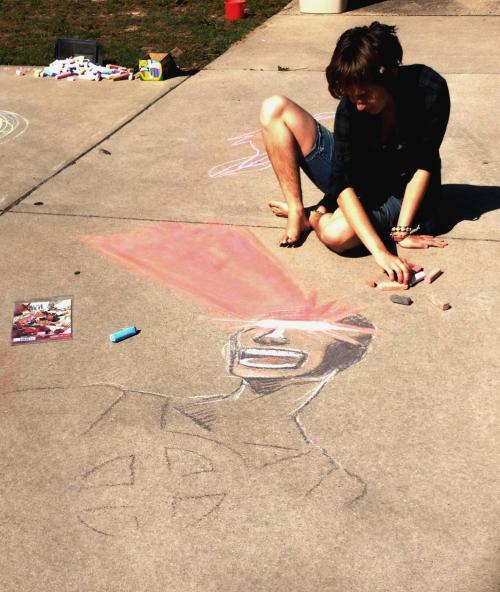My friend Julia helped me with the eye beams I love sidewalk chalk okay and drawing x-men