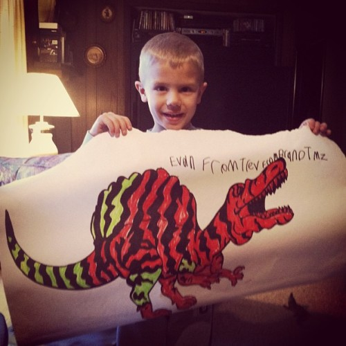 During the fall I sketched my nephew a Spinosaurus. He came up with the color scheme on his own.