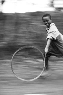 yourcupofcoffee:  yagazieemezi:  A young boy playing outside of a school in Nanyuki, Kenya. Classic home-made toy.  Masha'allah