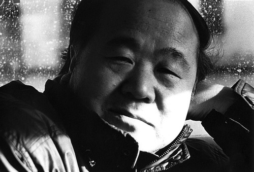 "Chinese writer Mo Yan was awarded 2012 Nobel Prize in Literature in Stockholm earlier today. In this excerpt from his part fiction, part memoir Change, he writes about his experience in the People's Liberation Army.  ""The command to which we reported was in far off Beijing, so oversight was assigned to the 34th Brigade of the Penglai Garrison Command, stationed in Huang County, and charged with the responsibility of supervising our activities. Supervise! They did their best, but never really could supervise us nor did they dare to. Our unit designation was '263,' and any mention of '263' so depressed the commander of the 34th Brigade that his blood pressure would shoot up and his political commissar would simply roll his eyes. That tells you the sort of shitty unit I was assigned to.""  Photo: Mo Yan by Naveen Kishore"