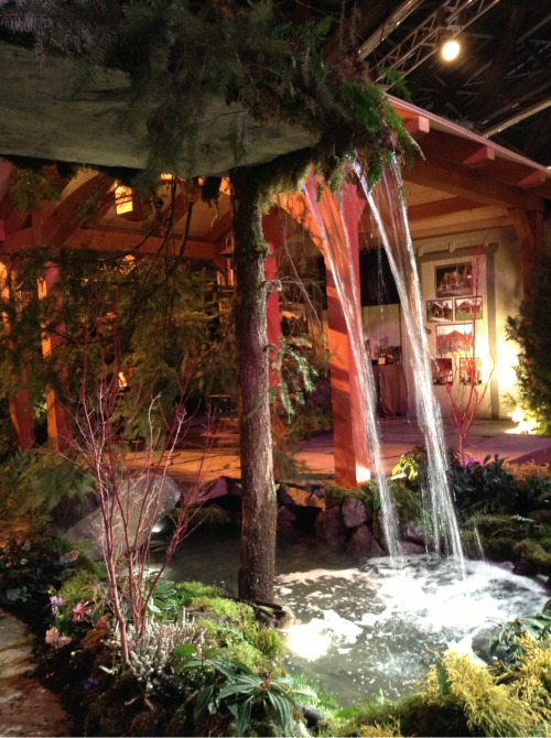 You can walk behind this waterfall at the showcase garden by All Nature's Construction.