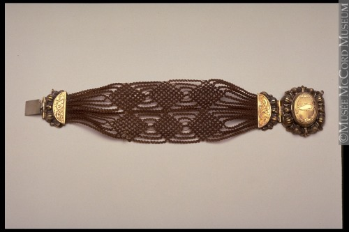 Mourning bracelet, 1840-60, McCord Museum  Jewellery made from hair was very popular in the mid-19th century. Symbols of life, hair has long been associated in many societies with funeral rituals. This piece of mourning jewellery, worn during this period in memory of the deceased, was a reminder of the inevitability of death. However its price, sometimes high, also made it a symbol of social status.When the hair was that of a friend or living relative, the piece of jewelry was worn as a token of esteem. This one, however, was no doubt made from the hair of a deceased person and worn in his or her memory. Such jewelry was not acceptable during the period of deep mourning, when only jet accessories were permitted. What Hair is a material that can be braided, woven, sown, knotted and coiled to produce all kinds of shapes and patterns. Horsehair was also used for this type of jewelry.  Where Not all hair jewelry was made by jewellers. Magazines explained to their readers how to make it at home.  When This kind of jewelry had existed in Europe since the late 17th century.  Who Bracelets, necklaces, earrings and watch chains were made of both men's hair and women's hair.