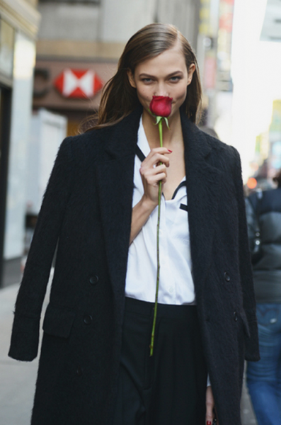 Karlie Kloss photographed by Tommy Ton after Calvin Klein Fall 2013, New York