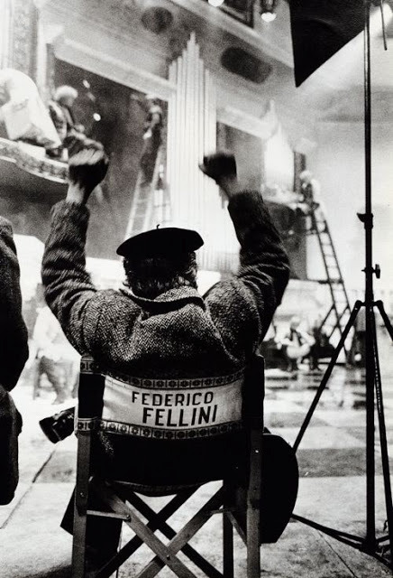 A Guest in My Own Dreams: An Interview with Federico Fellini, Film Quarterly, Spring 1994 [pdf] This is probably one of the best interviews with Fellini.  The conversation which follows did not take place all at once. Although I had known Federico Fellini since 1956, when he came to New York to publicize Nights of Cabiria and appeared on my radio show, and although I had written about him extensively, made a documentary about him (Ciao, Federico!), and photographed him continually for 37 years, we had not actually sat down to discuss his filmmaking ideas and his life philosophy until a few years before his death.    This was not because I did not ask him. It was, I now think, his reluctance to sound definitive about anything, and especially about himself, which made him postpone again and again a long-promised, lengthy, and in-depth conversation on these topics. Even the simple telling of the facts of his life kept being postponed. And although once, in 1962, after I had worked with him on 8'/2 and was following him during the shooting of Juliet of the Spirits, he sat down with me on a rainy afternoon and allowed me to record his story on five hours of tape, he was beside himself when these tapes were lost and refused to do new ones. I think this is because the story would not have been the same if he had tried again. He would have invented another life, a risk he probably wished to avoid in case the first tapes ever showed up.    But after City of Women, on which my companion, Deborah Beer, was the set photographer (as she was on And the Ship Sails On and on Ginger and Fred), he became somewhat more open to the suggestion of talking about himself in what I told him would be a discussion in depth. He smiled at this definition but he did not refuse, although at the same time he practically stopped giving journalistic interviews. From today's vantage point, I can't help feeling that for Fellini, allowing this discussion was a small way of giving up a battle for continual renewal.    I hope to convey, with these excerpts from many hours of tape, an image of a man who has shaped our vision of the century. —Gideon Bachmann