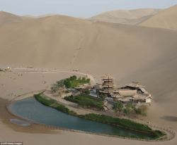 error888:  Crescent Lake: Tiny 2,000-year-old oasis in China that keeps city alive is saved from being swallowed by desert | Mail Online