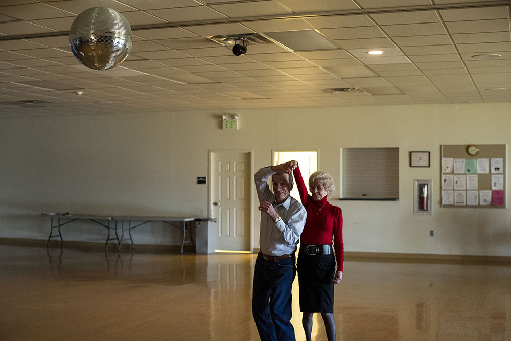 Valentine's Day dance at the Halls Senior Center. The single disco ball, an empty room, and the expression on the gentleman's face makes for delightful photograph.