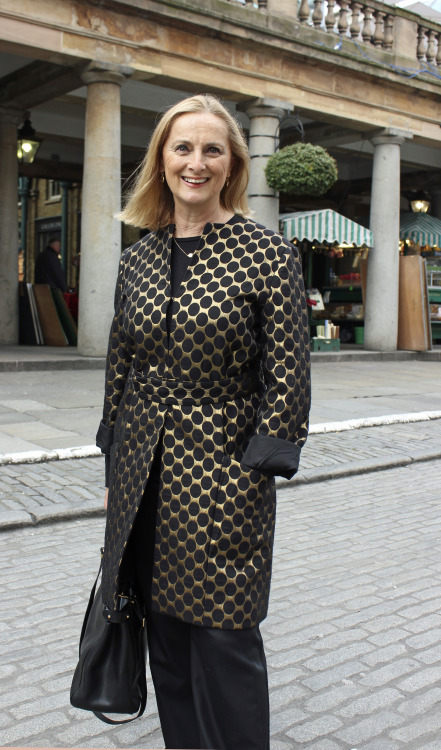 What the grownups are are wearing in London: Style on Call's Jane de Teliga in Covent Garden during London Fashion Week for Autumn Winter 2013. Jane wears a Diane Von Furstenberg black and gold wool coat, Cos top, MaxMara trousers, Whyred bag and Ram diamond earrings and necklace.  Photograph taken by photographer Vanessa Jackman.
