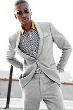 suitdup:  young man, be a grown up and put on a belt. is this a trend? i hope not. although i am digging the matching of mustard and grey.