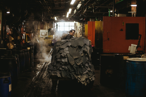 "haberdashmen:  Horween Leather Co. | Chicago, IL   'Horween stands with an ever-growing amount of people who intend to make their money count. In a world of cheap, quick and ""who cares,"" here stands a lot of folks who reply, ""We do.""    Read the full story here. Photo by Grant Legan  Team Haberdash went to Horween Leather Co. Tom wrote about it. Grant took photos MJ developed new product. I, uh…drove us there."
