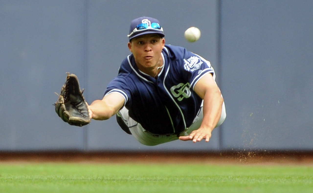 San Diego Padres center fielder Will Venable makes a diving catch on July 25, 2013.