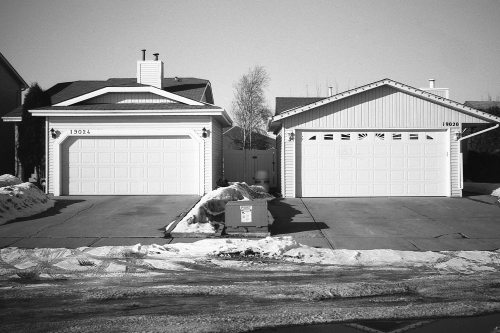 citiesandcitizens:  Aldergrove, Edmonton, ABMarch 2013 Is the garage attached to the house or the house attached to the garage?  I can't remember.