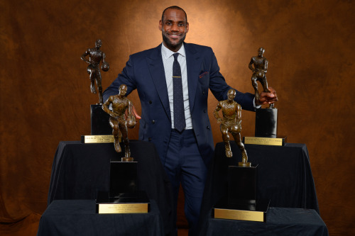 nba:  LeBron James of the Miami Heat poses with his collection of Maurice Podoloff Trophies after being named the 2012-2013 Kia NBA Most Valuable Player (MVP) of the Year for the fourth time on May 5, 2013 at American Airlines Arena in Miami, Florida. (Photo by Jesse D. Garrabrant/NBAE via Getty Images)  Dear young Jazz players, take note. This suit is PHENOMENAL. Ties a little skinny, and he should have had some pictures snapped with his DB done up, but seriously so good. Just so good.