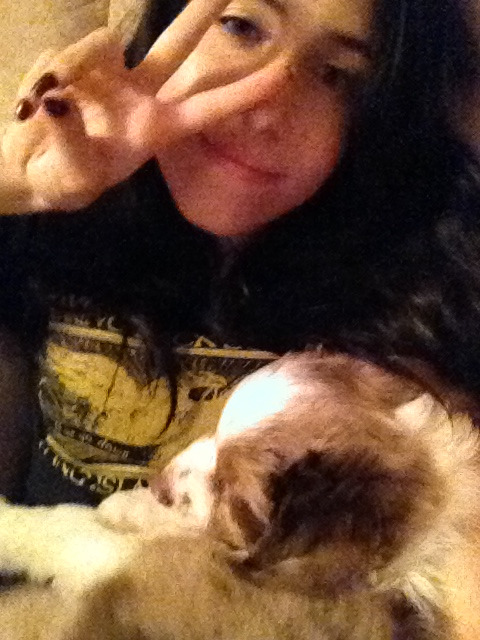 Goth girl cuddles with the sleepiest puppy ever