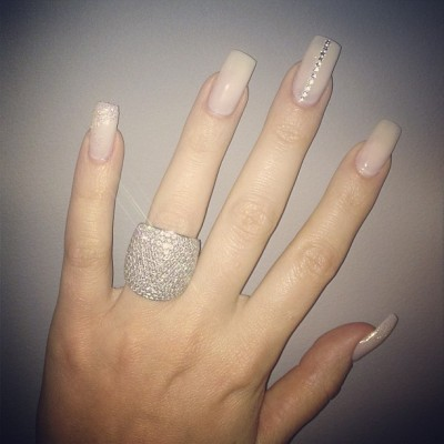 "khloekworld:  Khloe: ""Thank you @theeforevermalika for picking my nail design with me glitter and stones."""