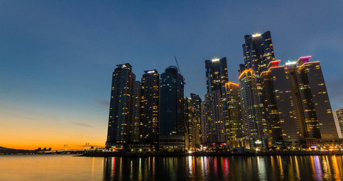 Sunset over Busan on Flickr.Via Flickr: Dongbaek Park is one of the best locations for taking night shots of Busan. There are the fantastic towers in front, and in the back is the beautiful Gwangan bridge.  It was very cold when I was taking these photos but well worth the effort. I could tell by the clear day that this would be a perfect evening for sunset photography. I was practically running to the end of the park with my tripod in tow to make it in time for these shots. But I got there in time.  If you are in Busan, I recommend checking out Dongbaek Park - there were several photographers there when I visited but none with tripods. You can easily walk there from Haeundae beach.