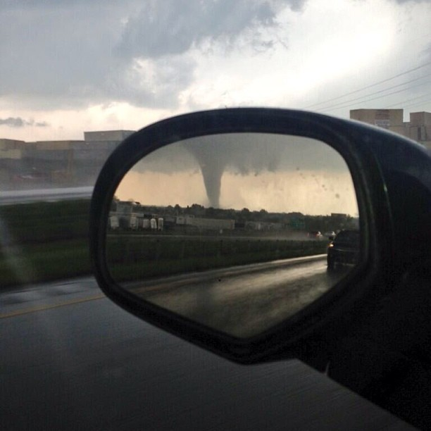 nbcnews:  Photo of the Moore tornado in a viewer's wing mirror. Source is safe and requested to remain anonymous.