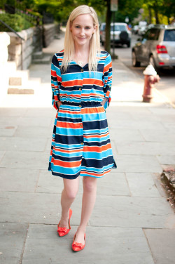 We love Kelly's bright persimmon, navy and white striped dress…Upper West Side, NYC (via Kelly in the City)