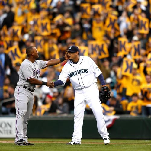Former teammate Adrian Beltre congratulates Felix Hernandez on achieving his 1,500th career strikeout.
