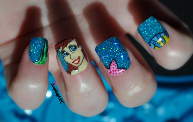 The Little Mermaid nails :) Well, not exaaaaactly spot on, but hopefully Ariel-esque.The blue glittery polishes I started with felt very 'Under the Sea', so I decided to make the set mermaid themed :) At first I tried to paint a silhouette of a mermaid but couldn't get those right, so then thought I might as well try and paint Ariel's face instead.Too many clear top coats created bubbles :( But, I don't mind too much with these, it kinda goes with the theme so I'll pretend it was on purpose.. Haha :) xx