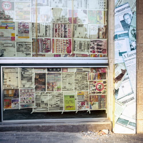 Duwar al-awal, Amman. A shop covered up with newspapers.