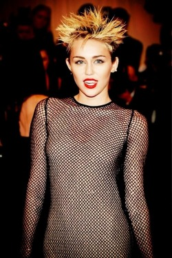 I dont care what everyone else is saying. For the theme of the night - Miley looks the part in a high fashion way. You go gurl.