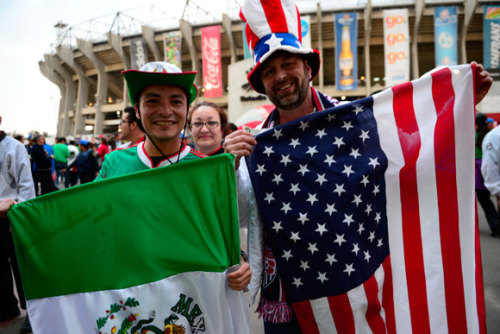 "In preparation for attending Tuesday's World Cup qualifier between Mexico and the United States, I was ordered to be discreet. The game was being played in Mexico City, at Estadio Azteca, in front of more than a hundred thousand Mexican soccer fans, so I shouldn't wear red, white, and blue. My haircut, I was told by a Mexican acquaintance, was too American, so she recommended a hat. Walking into the stadium we saw a bus of American supporters being guarded by a line of police. My pants were hanging low, because belts were not allowed inside. ""That way you can't hit someone with it, and your fists are busy hiking your trousers up,"" a British expat living in Mexico City speculated…  Reeves Wiedeman on how to survive a soccer game at Estadio Azteca: http://nyr.kr/14rtxGK  Soccer fans at Azteca Stadium in Mexico City during a match between the U.S. and Mexico on Tuesday. Photo by Hector Vivas/LatinContent/Getty Images."