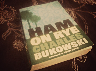 "thepoetandherbooks:  I just finished 'Ham On Rye', what a great read. Bukowski really channels the inner pessimist all of us have, and his blunt disgust with the world and the people around him was entertaining, in a depressing kind of way. I've read many of Bukowski's poems, but this was the first I've read of his novels. Any suggestions of which of his works I should read next?  ""At the age of 25 most people were finished. A whole god-damned nation of assholes driving automobiles, eating, having babies, doing everything in the worst way possible, like voting for the presidential candidate who reminded them most of themselves. I had no interests. I had no interest in anything. I had no idea how I was going to escape. At least the others had some taste for life. They seemed to understand something that I didn't understand. Maybe I was lacking. It was possible. I often felt inferior. I just wanted to get away from them. But there was no place to go. Suicide? Jesus Christ, just more work. I felt like sleeping for five years but they wouldn't let me."""