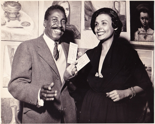 "Gordon Parks and Lena Horne, most likely on Saturday, October 29, 1949. I say ""most likely"" because the tickets in Ms. Horne's hand read: ""Cosmopolitan Tennis Club, Inc presents their Annual Fall Dance at The Renaissance Ballroom. The date: Saturday, October 29, 1949."" Photo via Dwayne Rodgers The Black Vernacular. Dwayne received this photo from Mr. Parks's daughter, Leslie Parks, and was kind enough to share it with me."