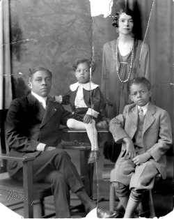 Portrait of Nathan McGill with wife Idalee and sons Simuel and Nathan Jr., 1925. Nathan was the first African American to serve as assistant attorney general for the State of Illinois. Photograph by Pew Hoffman.  Want a copy of this photo?  > Visit our Rights and Reproductions Department and give them this number: iChi-38796 Connect with the Museum