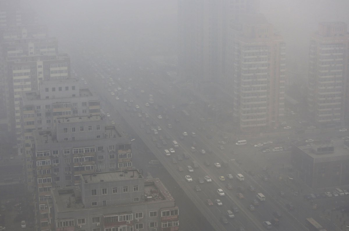 Cars drive on the Three Ring Road amid the heavy haze in Beijing, Feb. 26, 2014  by Jason Lee—Reuters