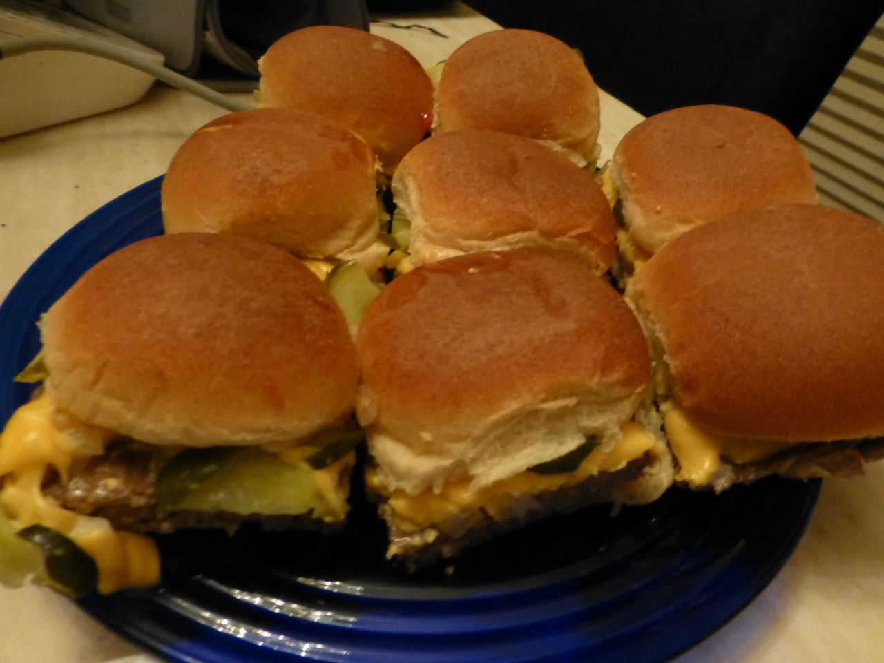 "wehavethemunchies:  On the west coast with no White Castle? No problem! I used to work there and know how to make them!  This is the best way to make them at home, the most signature part of the flavor of White Castles is actually their onion flavor and this reproduces it almost exactly. 1.5 pounds 80/20 ground beef 1 package onion soup mix 1 small onion, very finely chopped 1 dill pickle, sliced as thin as possible mustard/ketchup (if you want to feel authentic mix them together and then spread them on the bun) 12 soft dinner rolls (I like the Sara Lee ones) Good quality American Cheese sliced Mix the ground beef and onion soup mix in a bowl. Spread the ground beef on a 12-15"" cookie sheet. Use a rolling pin (or cover with parchment paper and flatten by hand) on the ground beef to flatten it out to about 1/4-1/2 inch thick. Bake at 350 degrees for 10 minutes. Take out and pour off grease. Spread diced onions along the edge of the sheet so they touch the sheet where the ground meat has shrunk away from. Bake for 15 more minutes then spread the onions evenly on top of the ground beef and layer with cheese slices. Bake another 6 minutes to melt cheese. While waiting slice your dinner rolls and wrap them all in a damp paper towel. Microwave them in the paper towel for 60 seconds to steam them. (You can also load them in a tortilla warmer instead of a paper towel if you have one.) Spread out the top buns and add mustard and ketchup on them just before you are ready to remove the ground beef from the oven. Take it out of the oven. Spread as many pickles as you like on top of the cheese. Arrange the top buns on the ground beef to make hamburgers. Slice the ground beef between the buns with a pizza cutter and pick up the top bun and burger with a spatula and set it on the bottom bun. Holy Crap, you just made fresh White Castles at home! Enjoy!"