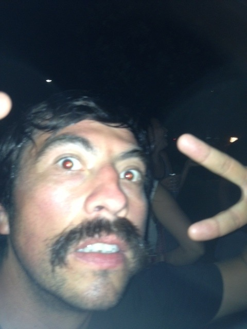Location: Byron Bay, Australia This moustache fueled by a cocktail of MDMA, vodka/red bull, sweat and marijuana. Not sure what's worse, his eyeballs or his unkempt tash.