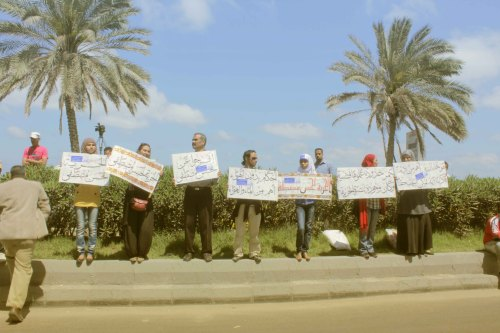 Photo by: Mohamed el-Masry Protest in Alexandria, Egypt, demonstrating against detention of activist Hassan Mustafa. This family used to participate in different protests all over the country, always holding their demands written in a beautiful Arabic calligraphy submitted by http://fadlahmed.tumblr.com/