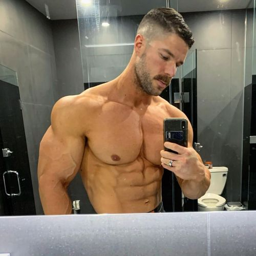 hugemuscle:Taking a pic to send to his sub sluts.😈   His pecs & biceps 🌴