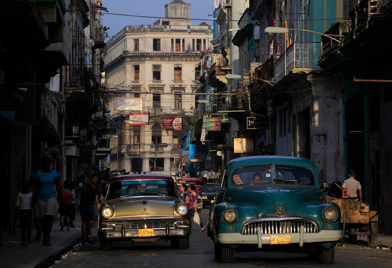 Cars used as taxis drive through the streets of Havana on March 18, 2013. [Credit : Enrique De La Osa/Reuters]