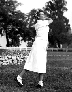 Rita Hayworth playing golf, 1950