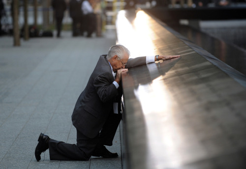 Robert Peraza pauses at his son's name on the 9/11 Memorial during the tenth anniversary ceremonies at the site of the World Trade Center.
