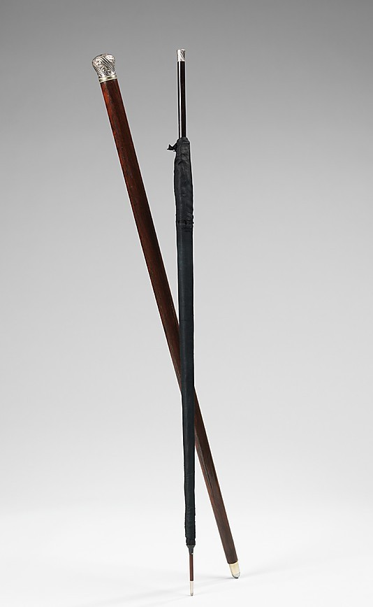 "omgthatdress:  Cane with Inner Umbrella 1880-1889 The Metropolitan Museum of Art ""Canes were an elegant accessory in the 19th century, when the afternoon promenade gave members of the fashionable set occasion to display their finery and genteel manners. This novelty cane contains a miraculously slender umbrella, thus tripling its functionality for looking chic, walking steadily, and protecting the user from an inclement turn in the weather. Constructing an umbrella this slim required refined mechanical technology, an advancement on which umbrella manufacturers prided themselves in the late 19th century. While similar devices are still manufactured today, the beautifully slim and tapered line of the earlier pieces is no longer seen."""