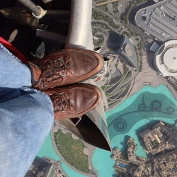theatlantic:  An Utterly Terrifying Picture Taken From the Top of the Burj Khalifa  Earlier this week, fearless photographer Joe McNally uploaded this image on his Instragram feed. [Image: @joemcnally]