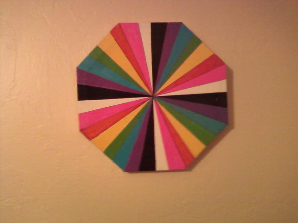 octagon canvas with rainbow rays in paint markers
