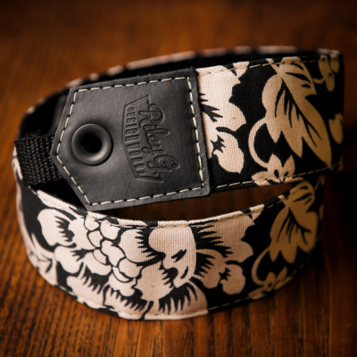 chezcastel:  Really cool floral strap by Riley G! I need one of those, hate my Canon one…