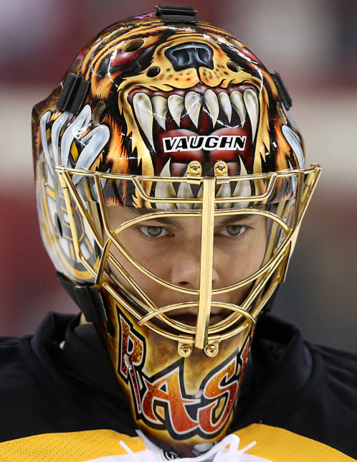 siphotos:  Bruins goalie Tuukka Rask shows off his mask during Monday's 5-3 victory over Carolina. (Andy Mead/YCJ/Icon SMI)