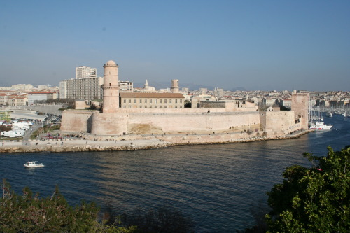 "Fort Saint-Jean à Marseille @credits  Fort Saint-Jean is a fortification in Marseille, built in 1660 by Louis XIV at the entrance to the Old Port. Since 2013 it is linked by two thin bridges to the historical district Le Panier and to the first French national museum outside Paris called Musée des Civilisations de l'Europe et de la Méditerranée. Fort Saint-Jean was built on a site earlier occupied by the Military Order of the Knights Hospitaller of Saint John, from which the new building deprived its name. Fort Saint-Nicolas was constructed at the same time on the opposite side of the harbour. Commenting on their construction, Louis XIV said, ""We noticed that the inhabitants of Marseille were extremely fond of nice fortresses. We wanted to have our own at the entrance to this great port."" [1] In fact, the two new forts were built in response to a local uprising against the governor, rather than for the defence of the city: their cannons pointed inwards towards the town, not outwards towards the sea."