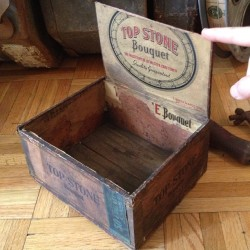 Found this 1926 cigar box in  a pile of old cans and tools in an abandoned theater projector room