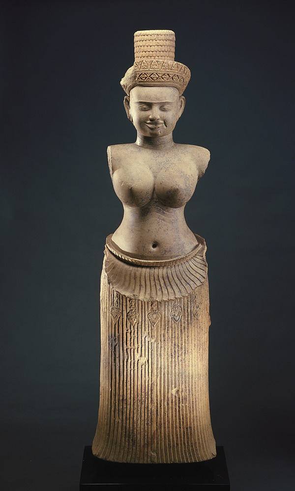 ethnoarte:  The Goddess Uma 10th century Angkor period Sandstone H: 124.2 W: 37.5 D: 24.3 cm Koh Ker, Cambodia Gift of Arthur M. Sackler S1987.909 This hierarchic majestic figure wears a precisely pleated skirt whose downturned upper edge creates a prominent fold over the belt with dangling tassels visible below. This convention is typcial of the tenth-century Angkor style. Three incised lines below her breast and along her neck express the ideal of ample beauty. While she lacks identifying attributes, the cylindrical shape of her hairstyle and the jeweled diadem on her forehead indicate that she is a goddess. The absence of a Buddha in her headdress suggests she is a Hindu deity, most likely Uma, consort of the god Shiva. (via Southeast Asian Art Collection Highlights | Collections Online | Freer and Sackler Galleries)