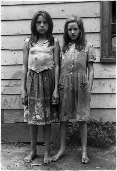 collectivehistory:  Two girls with dirty clothes holding hands ca. 1964 by William Gedney (Duke Special Collections Library)