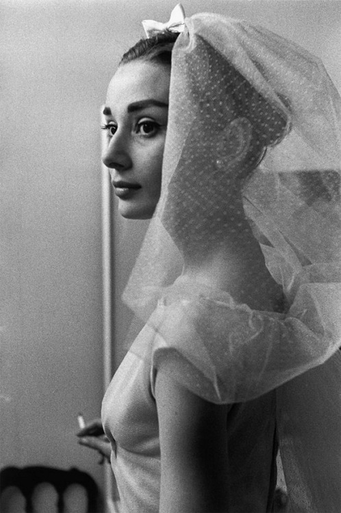 "Audrey Hepburn on the set of Funny Face (1956, photo by David Seymour) (via) ""Why, she was pressed, does she think she provoked such strong feelings of empathy from her audiences? After all, she was not a sex symbol ('I sure wasn't'), so what was it - her beauty, her vulnerability, her sense of humor, her sensitivity? - that gave her that special aura? 'It's impossible for me to know,' [Audrey Hepburn] said with hesitation, 'but if you asked me what I would like it to be, though it may sound presumptuous to say so, it's an experience I've had with other performers who somehow make you open up to them. For me, it always has to do with some kind of affection, love, a warmth.' 'I myself was born with an enormous need for affection and a terrible need to give it,' she went on. 'That's what I'd like to think maybe has been the appeal. People have recognized something in me they have themselves — the need to receive affection and the need to give it. Does that sound soppy?'"" -excerpted from New York Times interview, April 1991"