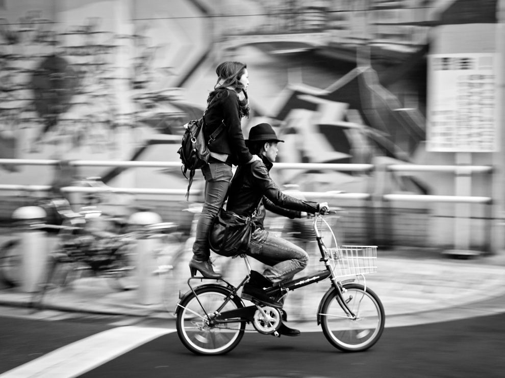 A couple riding a bicycle in Osaka by Sun Jie