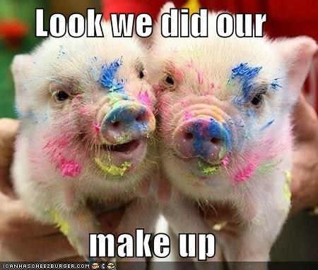 wow pigs doing there make up!Very funny! Paint on a pigs face! :)