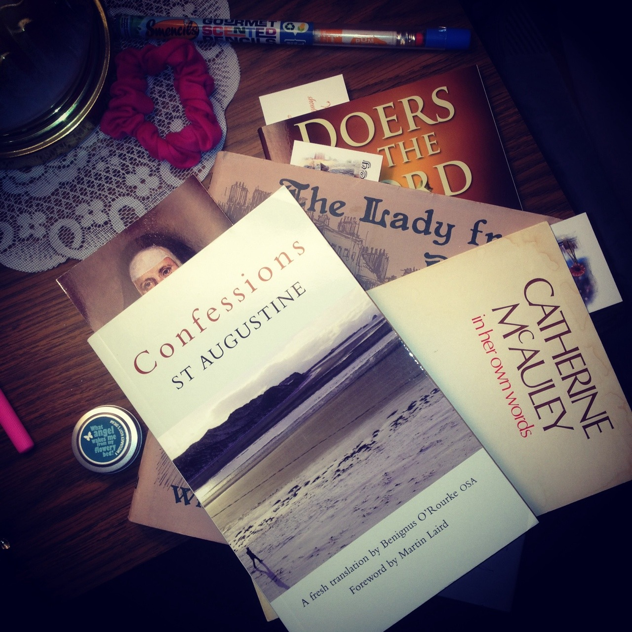 opentolisten:  My light reading.  The top book is the best book because I bought it for a God-willing-soon-to-be-sister. The first English translation of the Confessions, ENTIRELY in verse (just like Augustine wrote it!)